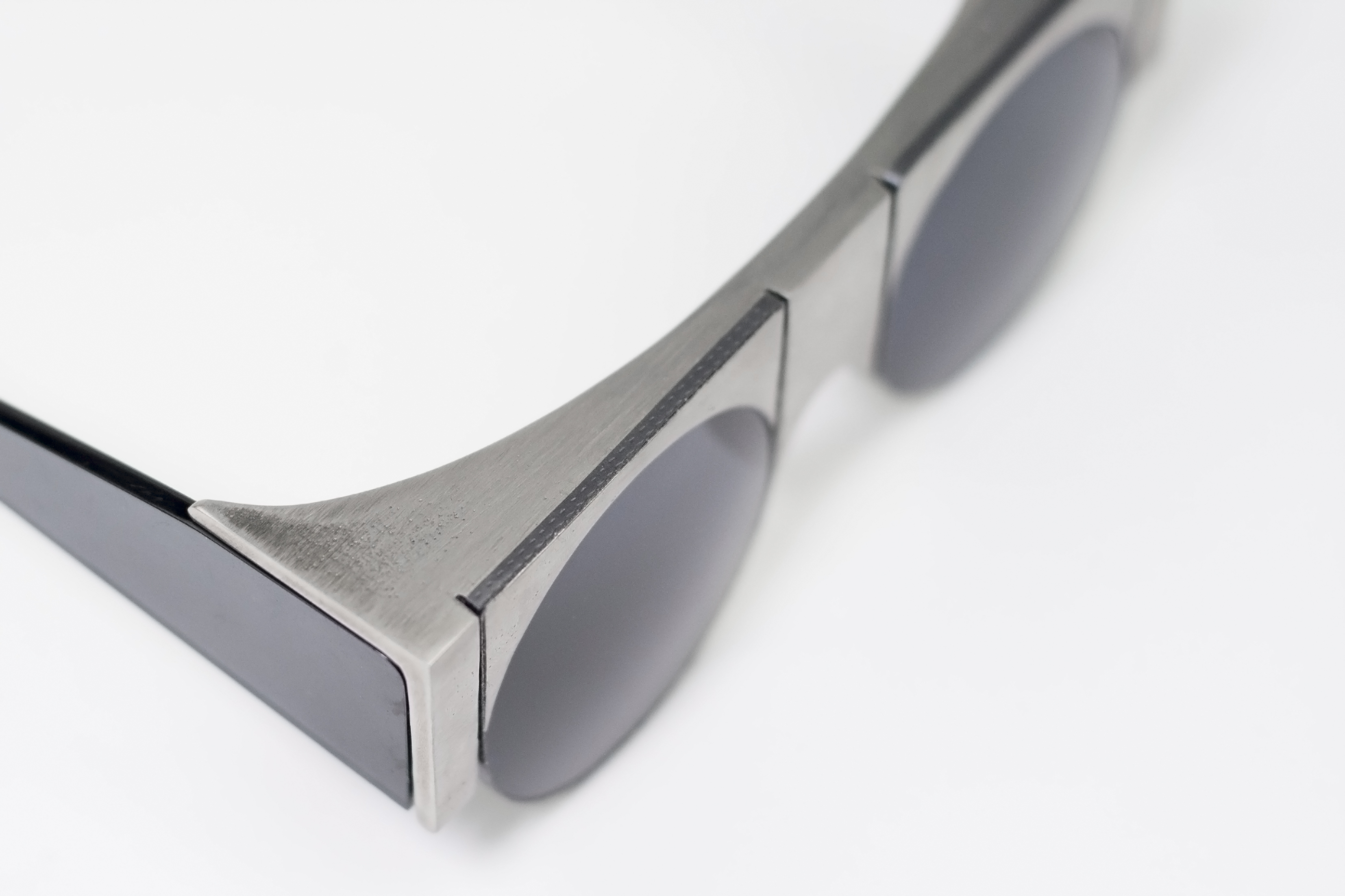 innovative eyewear  providence optical - highway overpass meets contemporary necklace a new line of eyewear is born